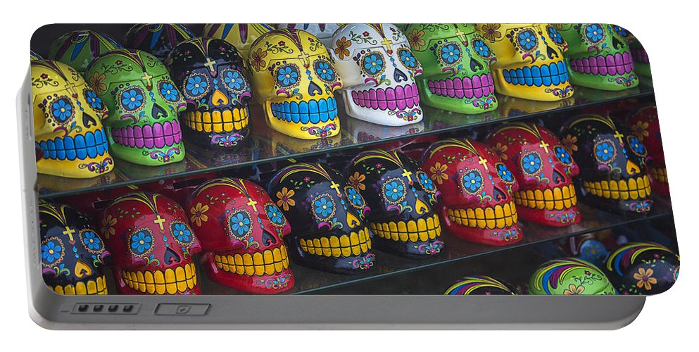 Rows. Row Portable Battery Charger featuring the photograph Rows Of Skulls by Garry Gay