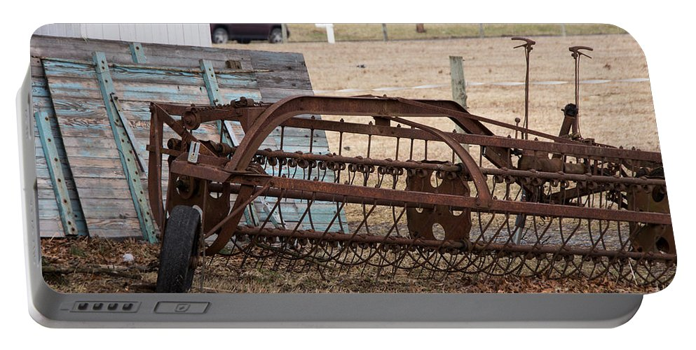 Farm Portable Battery Charger featuring the photograph Rusted Hay Rake by Jay Ressler