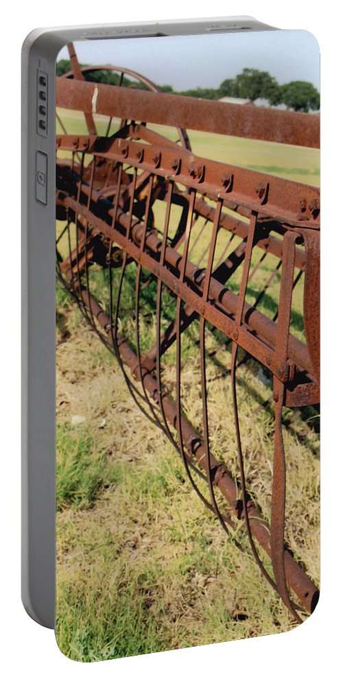 Manmade Portable Battery Charger featuring the photograph Rusty Hay Rake by Glenn Aker