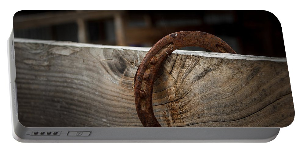 Horseshoe Portable Battery Charger featuring the photograph Rusty Horseshoe by Doug Long