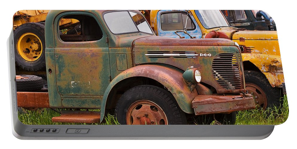 Truck Portable Battery Charger featuring the photograph Rusty Old Trucks by Louise Heusinkveld