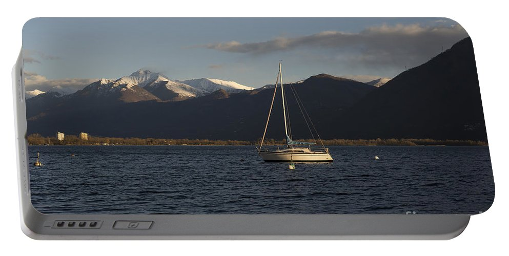 Boat Portable Battery Charger featuring the photograph Sailing Boat On An Alpine Lake by Mats Silvan