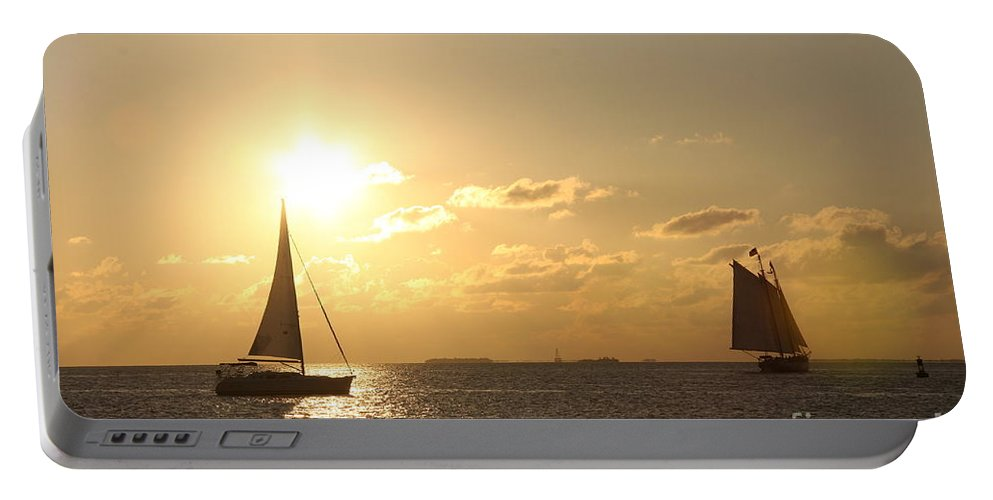 Sail Portable Battery Charger featuring the photograph Sailing Into The Sunset by Christiane Schulze Art And Photography