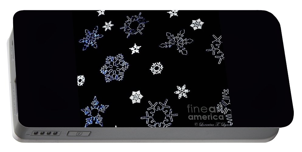 New York City Portable Battery Charger featuring the photograph Saks 5th Avenue Snowflakes by Living Color Photography Lorraine Lynch