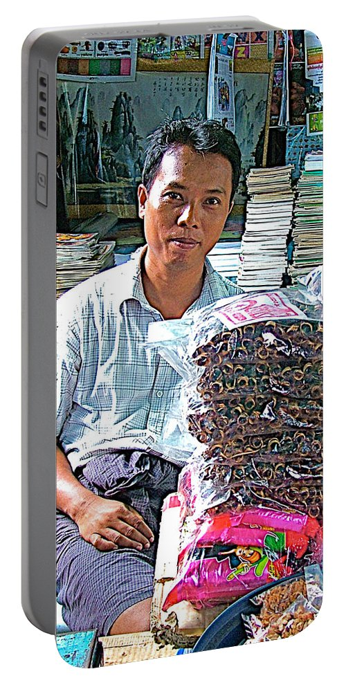 Salesman In Marketplace In Tachilek Portable Battery Charger featuring the photograph Salesman In The Marketplace In Tachilek-burma by Ruth Hager