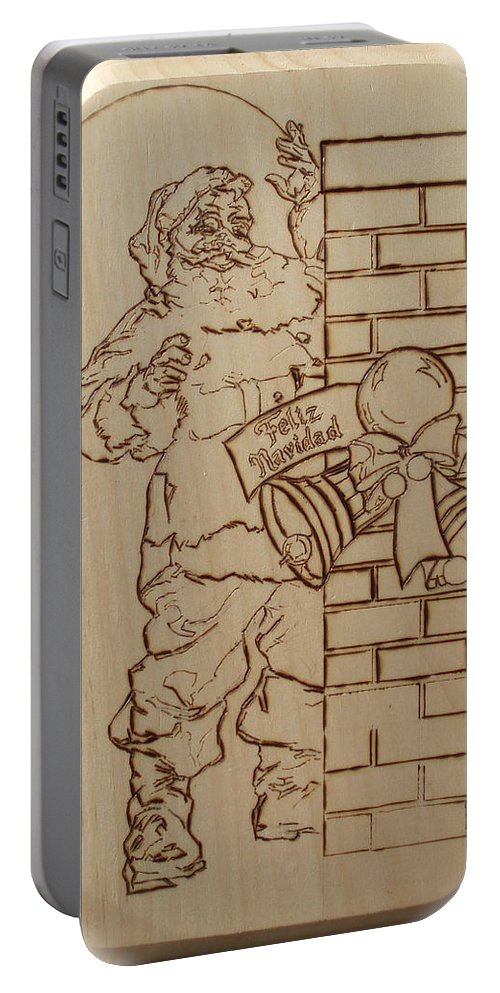 Pyrography Portable Battery Charger featuring the pyrography Santa Claus - Feliz Navidad by Sean Connolly