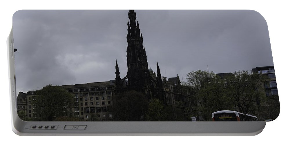Action Portable Battery Charger featuring the photograph Scott Monument Next To Waverley Train Station And With Sightseeing Buses by Ashish Agarwal