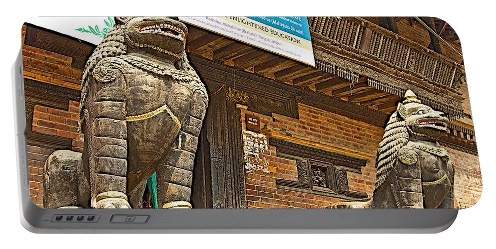 Sculptures Of Protector Figures In Front Of Sufata Buddhist College In Patan Durbar Square In Lalitpur In Nepal Portable Battery Charger featuring the photograph Sculptures Of Protector Figures In Front Of Sufata Buddhist College In Patan Durbar Square by Ruth Hager