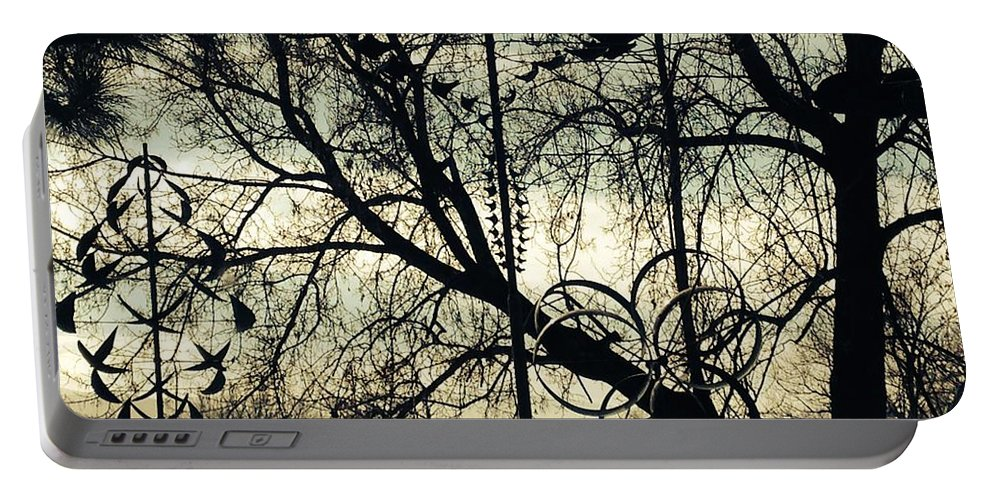 Silhouettes Portable Battery Charger featuring the photograph Shadow's Playground by LeLa Becker