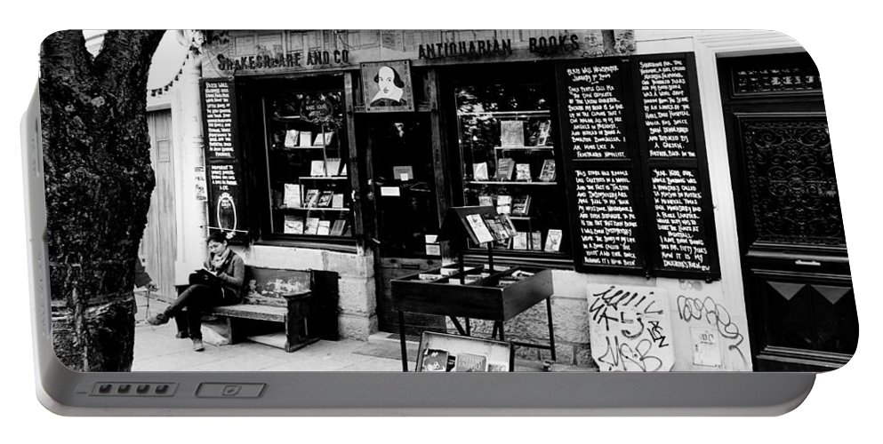 Paris Portable Battery Charger featuring the photograph Shakespeare And Company Boookstore In Paris France by Richard Rosenshein