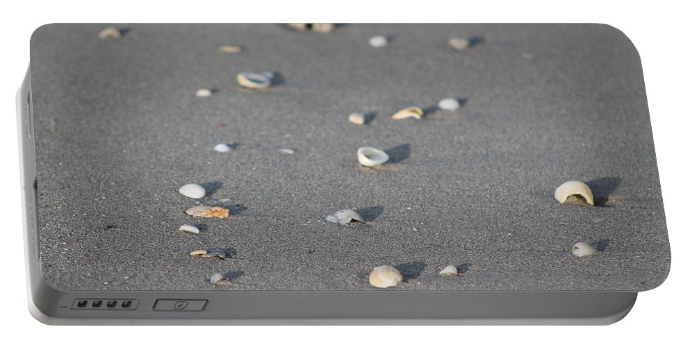Beach Portable Battery Charger featuring the photograph Shells On A Beach by Catie Canetti