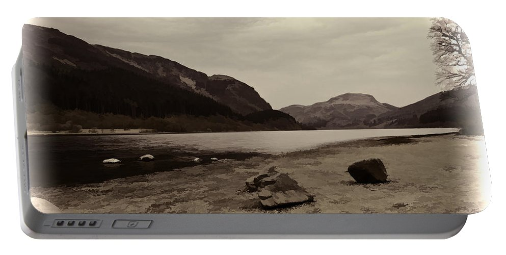 Beauty Of Scottish Highlands Portable Battery Charger featuring the photograph Shore Of A Loch In The Scottish Highlands by Ashish Agarwal