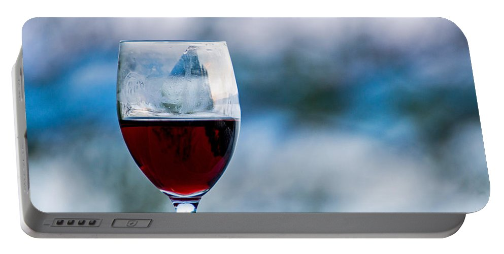 Red Portable Battery Charger featuring the photograph Single Glass Of Red Wine On Blue And White Background by Photographic Arts And Design Studio