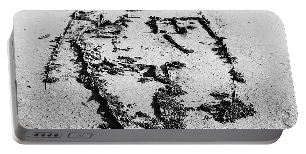 Anchor Portable Battery Charger featuring the photograph Skeleton Boat by Svetlana Sewell