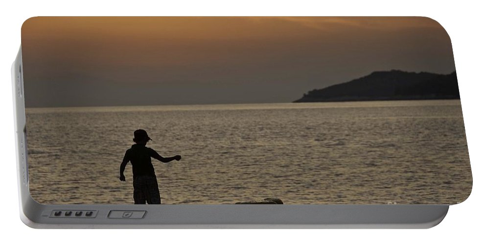 Skopelos Portable Battery Charger featuring the photograph Skopelos Sunset - Fisher Boy - 1 by James Lavott