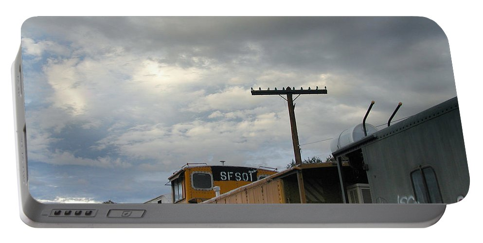 Sky Portable Battery Charger featuring the photograph Sky Clouds And Graffiti Old Santa Fe Railyard by Kathleen Grace