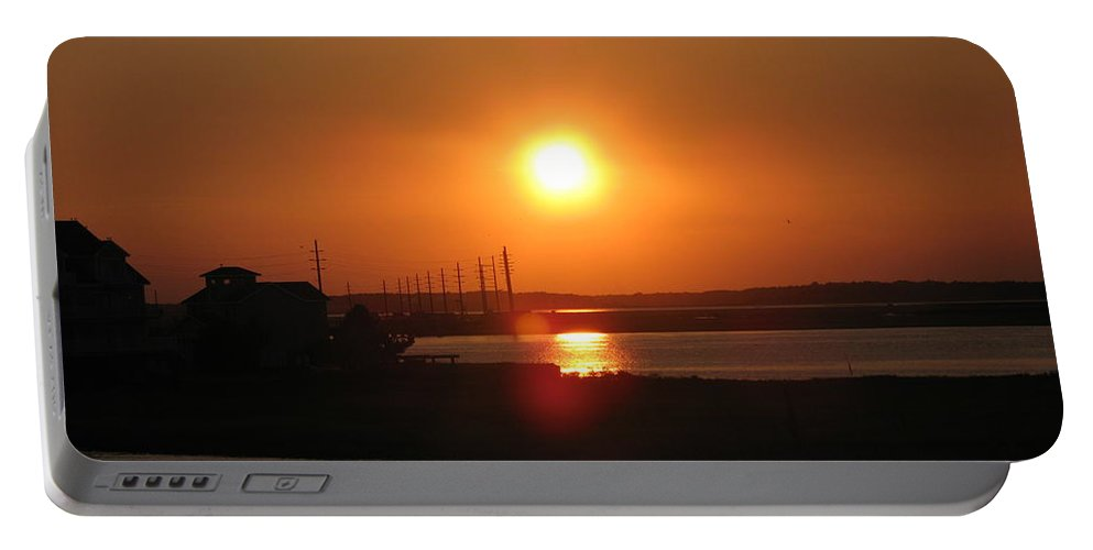 Sunset Portable Battery Charger featuring the photograph Sky On Fire Over Chincoteague Island by Christiane Schulze Art And Photography