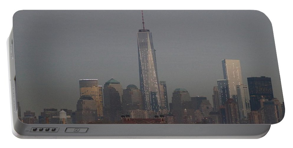 Freedom Portable Battery Charger featuring the photograph Skyline And Ellis Island At Dusk by John Wall