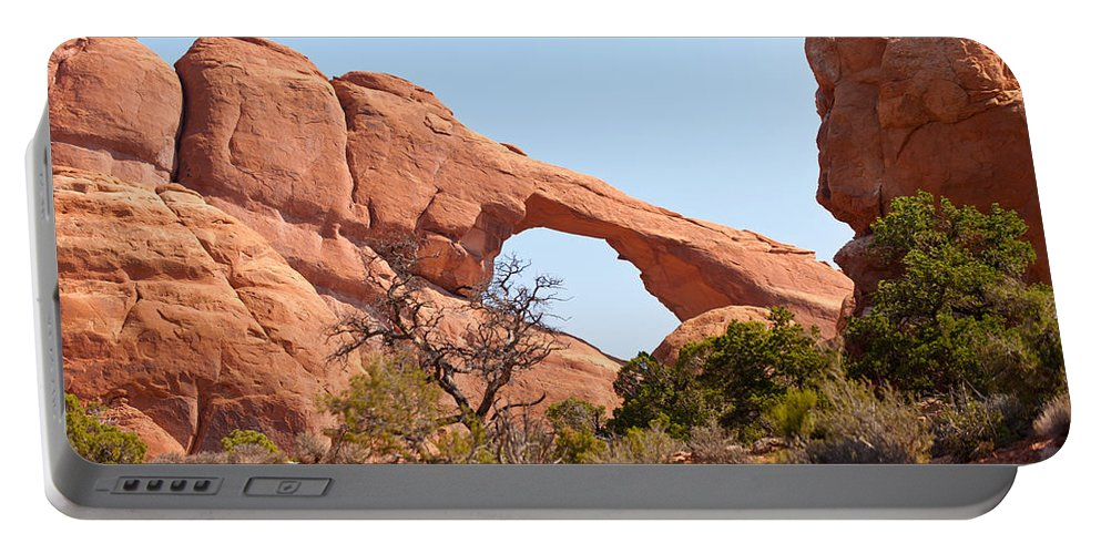 Rock Formations.juniper Trees Portable Battery Charger featuring the photograph Skyline Arch by Randy Giesbrecht