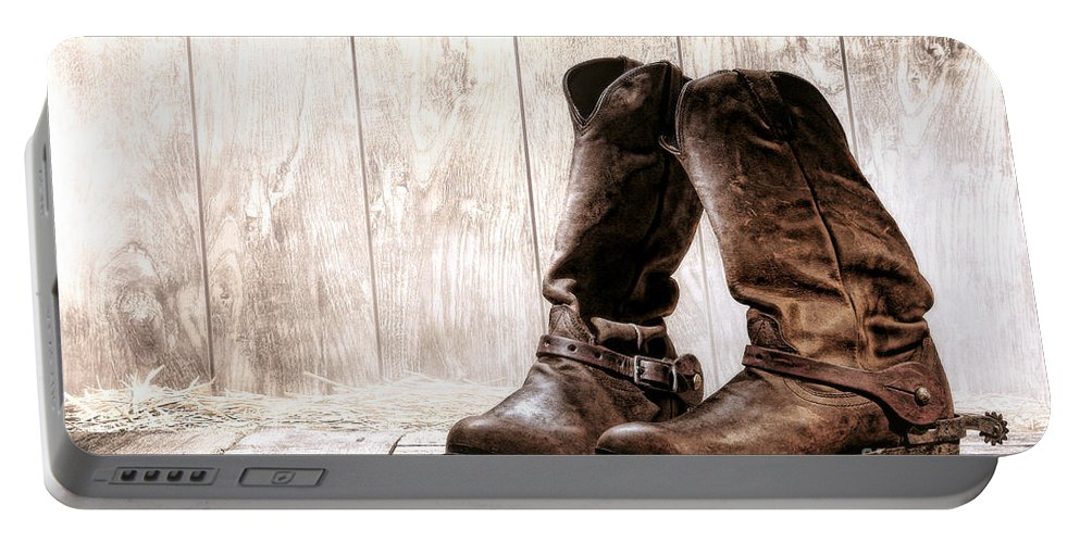 Western Portable Battery Charger featuring the photograph Slouch Cowboy Boots by Olivier Le Queinec