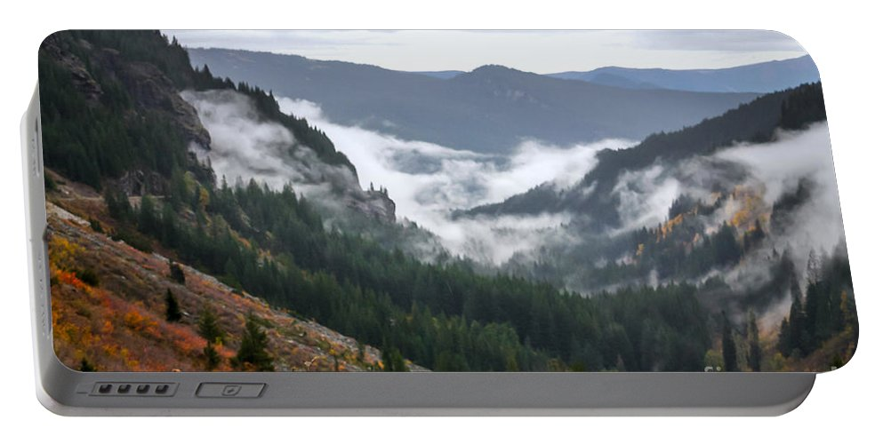 Mount Rainier Portable Battery Charger featuring the photograph Sly Fog Dance by DAC Photo