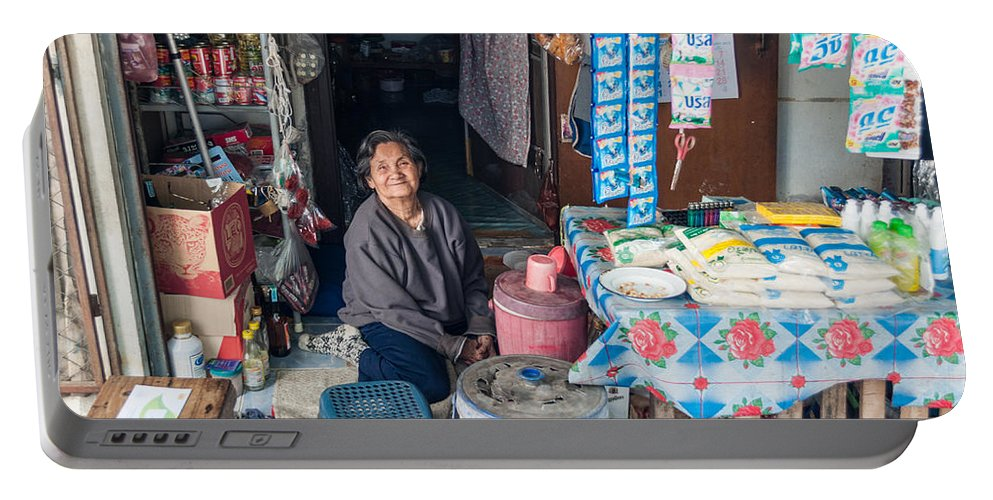 Outdoors Portable Battery Charger featuring the photograph Smiling Vendor by Jill Mitchell
