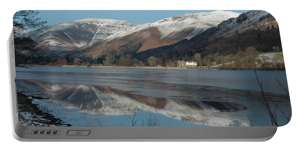 Lakedistrict Portable Battery Charger featuring the photograph Snow Lake Reflections by Kathy Spall