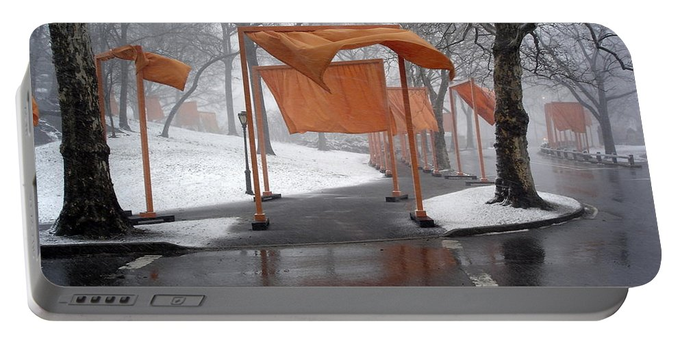 Orange Gates Portable Battery Charger featuring the photograph Snowy Day In Central Park by Gerry High