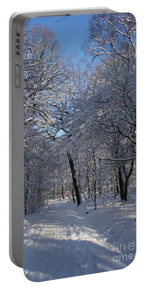 Forest Portable Battery Charger featuring the photograph Snowy Trail by Christiane Schulze Art And Photography