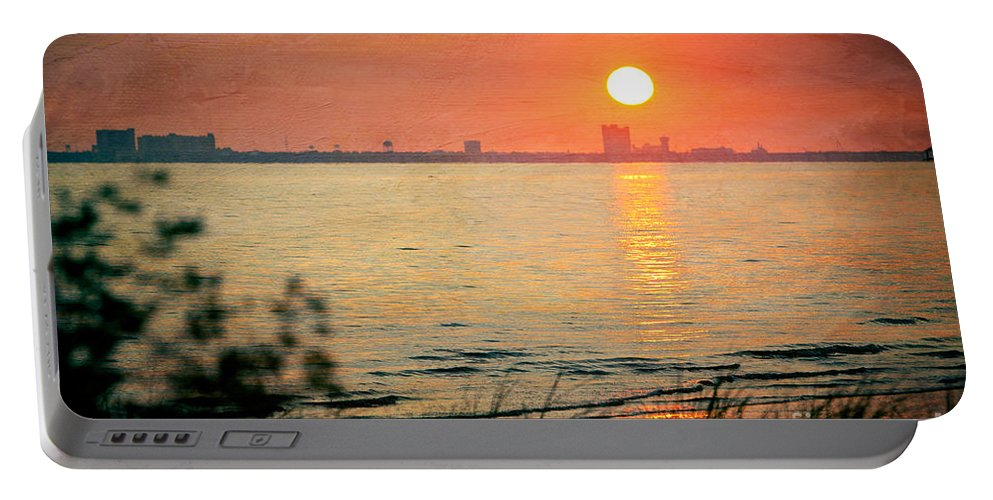 Sunset Portable Battery Charger featuring the photograph Solemness by Joan McCool