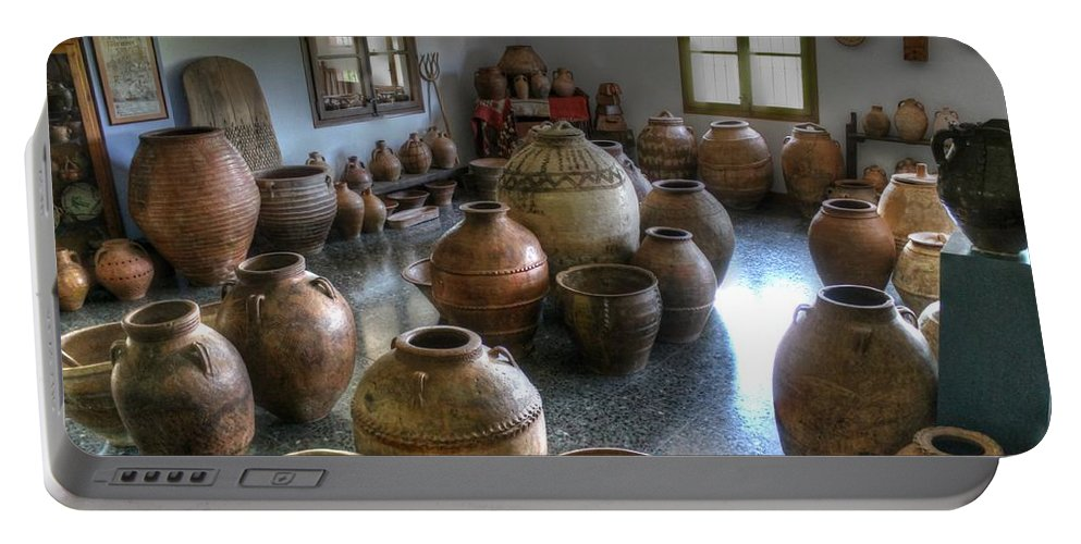 Pottery Portable Battery Charger featuring the photograph Spanish Pottery Shop by Jane Linders