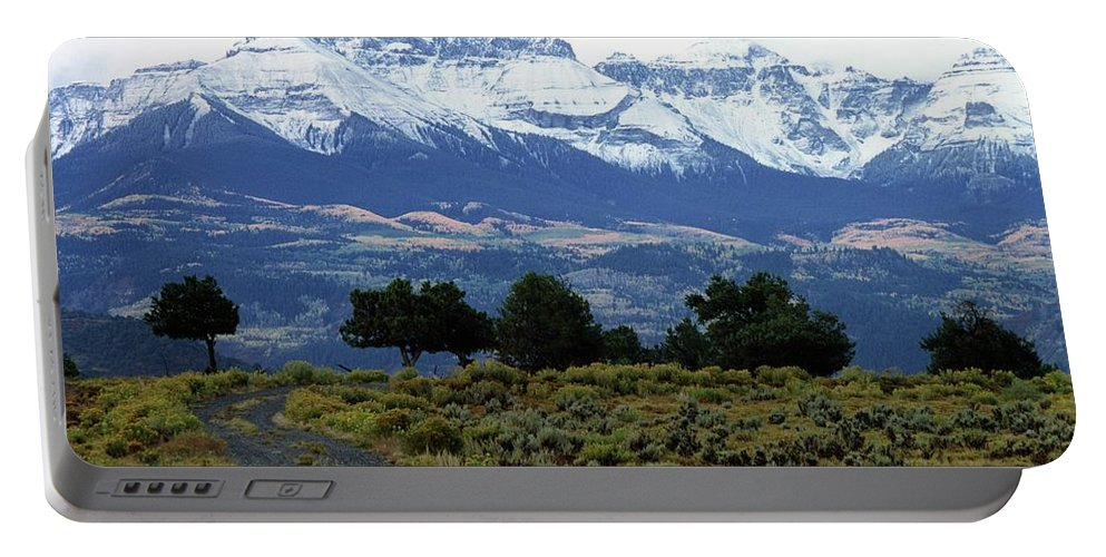 Colorado Portable Battery Charger featuring the photograph Speaking In Silence by Eric Glaser