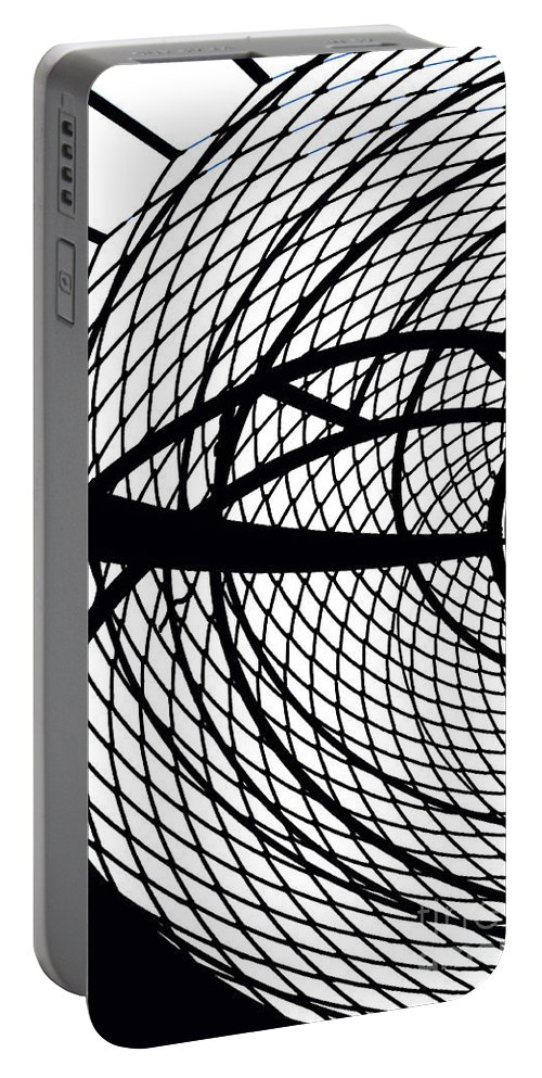 Abstract Black And White Portable Battery Charger featuring the photograph Spinning My Wheels by Regina Geoghan