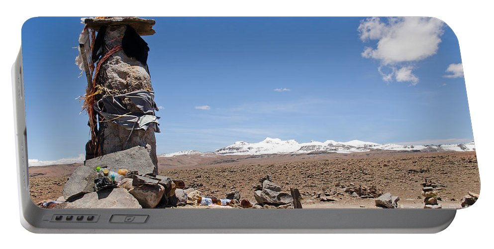 Cairns Portable Battery Charger featuring the photograph Spiritual Cairn In The Peruvian Altiplano by Ralf Broskvar