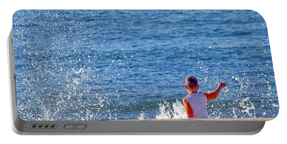 Ocean Portable Battery Charger featuring the photograph Splash Conductor by Keith Armstrong