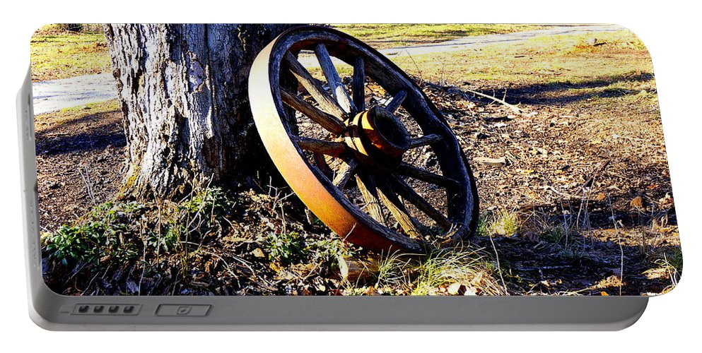 Wagon Portable Battery Charger featuring the photograph Spoked Off by Darrell Clakley