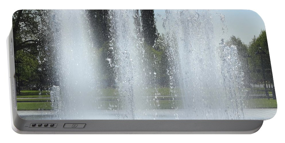 Water Fountain Portable Battery Charger featuring the photograph Spring H20 Sprays by Lee Serenethos