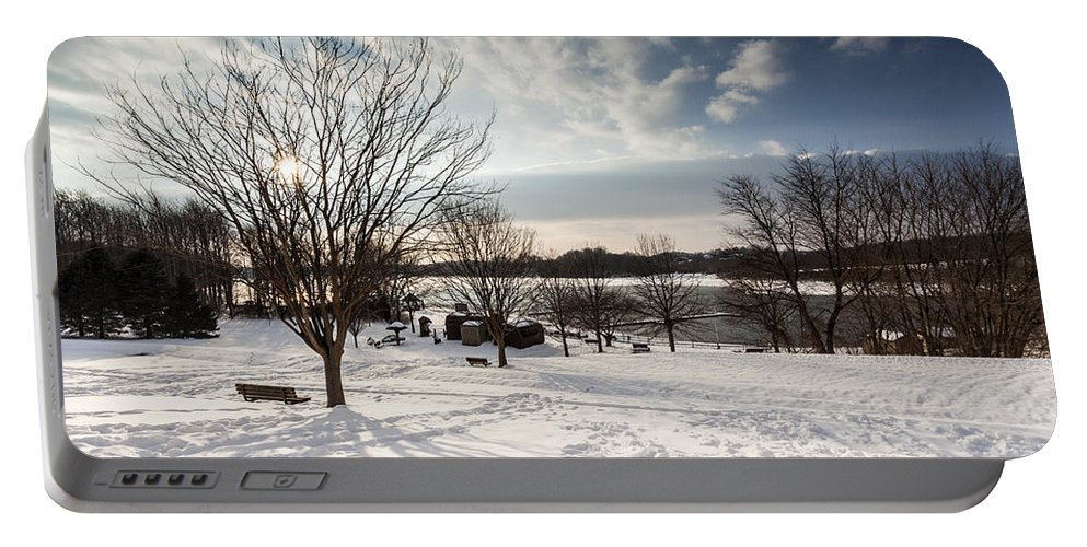 Winter Portable Battery Charger featuring the photograph Spring Is Buried Just Below The Snow by Edward Kreis