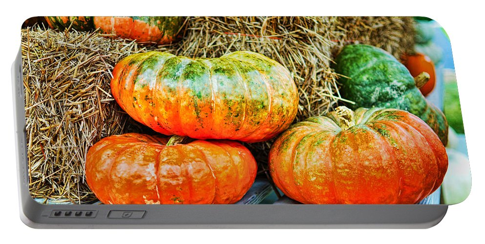 Outdoors Portable Battery Charger featuring the photograph Squatty Orange Pumpkins by Paulette B Wright