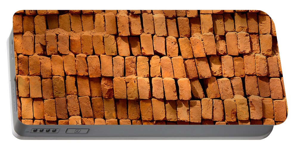 Stack Portable Battery Charger featuring the photograph Stack Of Bricks by Dutourdumonde Photography