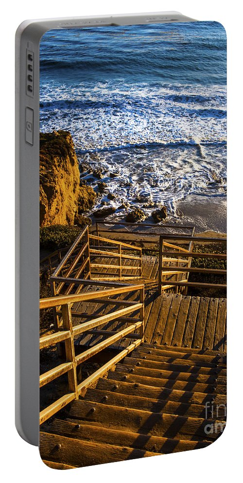 Steps To Blue Ocean Waves Photography Portable Battery Charger featuring the photograph Steps To Blue Ocean And Rocky Beach by Jerry Cowart