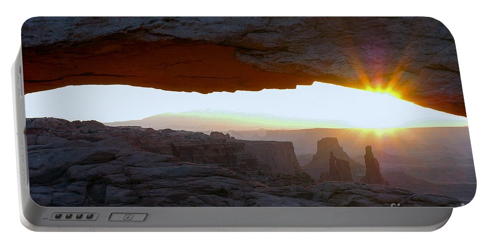 Mesa Arch Canyonlands National Park Utah Arches Sunrise Sunrises Red Rock Formation Formations Parks Reflected Light Early Morning Dawn Landscape Landscapes Landmark Landmarks Desertscape Desertscapes Portable Battery Charger featuring the photograph Starburst At Mesa Arch by Bob Phillips