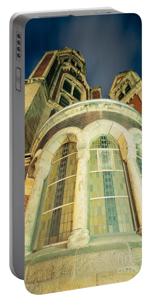Cathedral Portable Battery Charger featuring the photograph Stone Church Exterior Facade Windows At Night by Stephan Pietzko