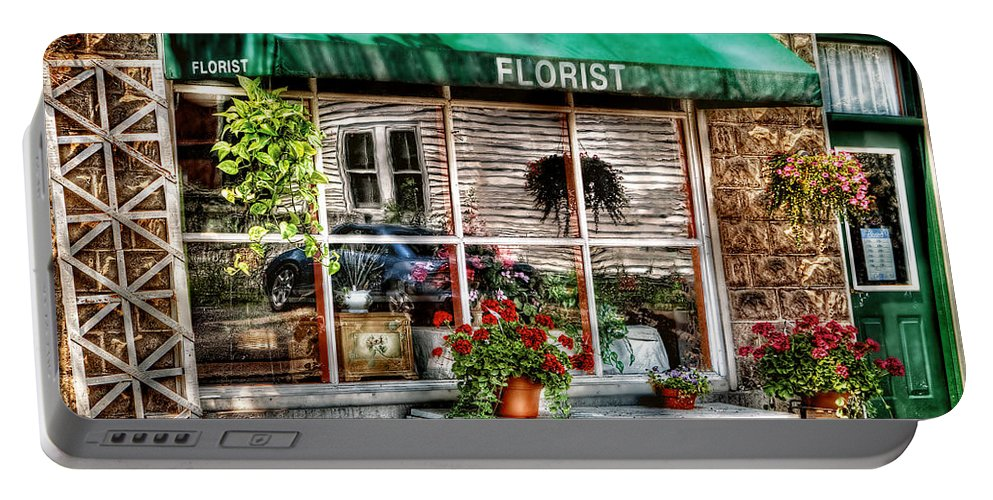 Awning Portable Battery Charger featuring the photograph Store - Florist by Mike Savad