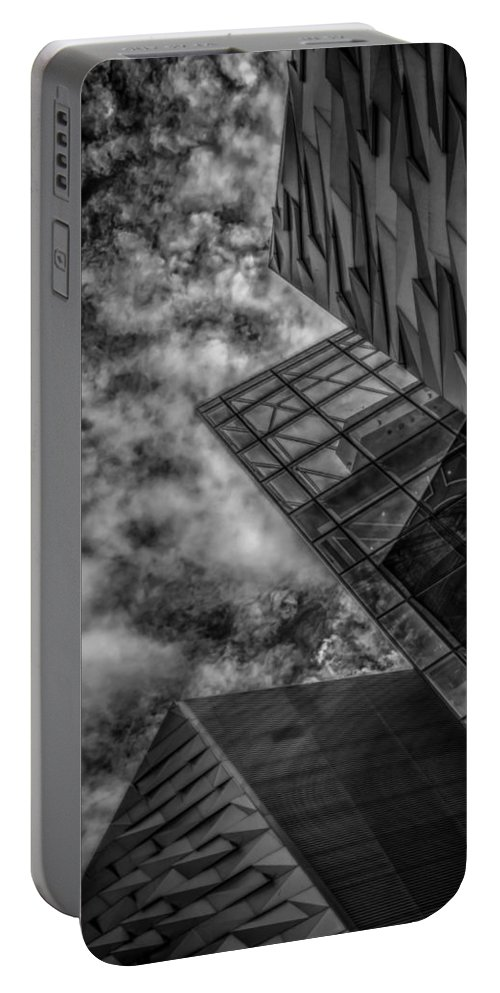 Bw Portable Battery Charger featuring the photograph Stormy Clouds Over Modern Building by Gareth Burge Photography