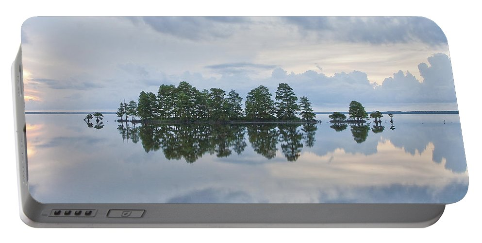 Clouds Portable Battery Charger featuring the photograph Stormy Morning On The Lake by Bill Swindaman