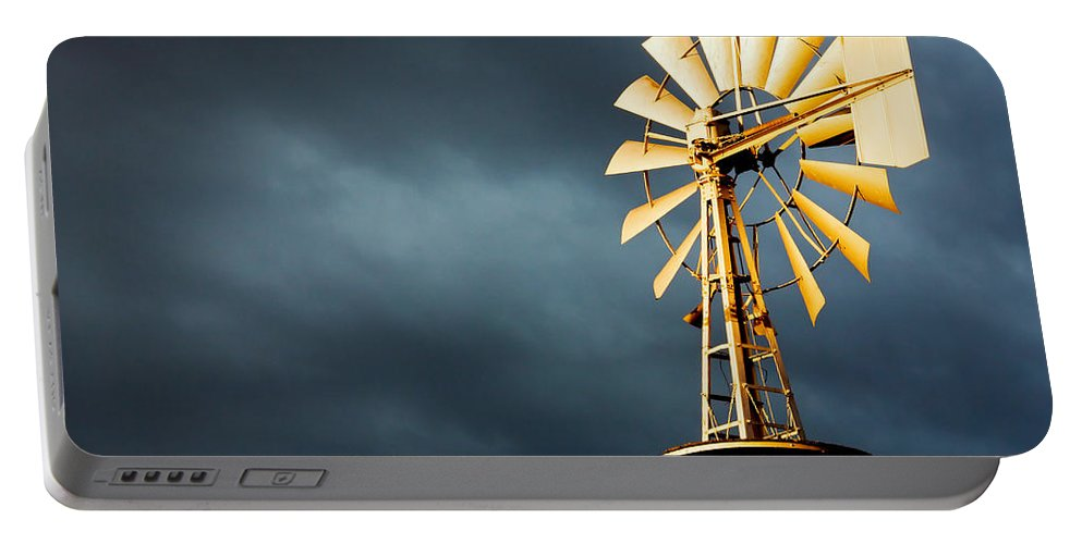 Stormy Portable Battery Charger featuring the photograph Stormy Skies by Todd Klassy