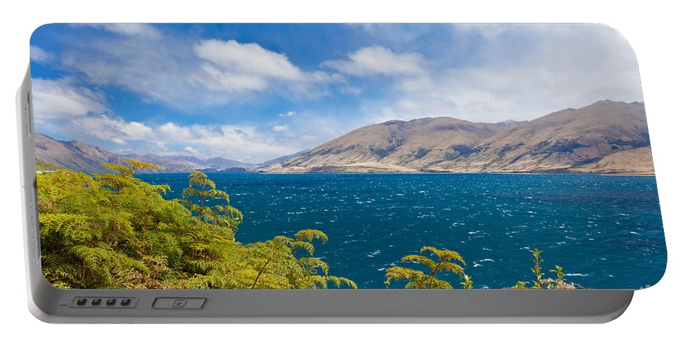 Beautiful Portable Battery Charger featuring the photograph Stormy Surface Of Lake Wanaka In Central Otago On South Island Of New Zealand by Stephan Pietzko