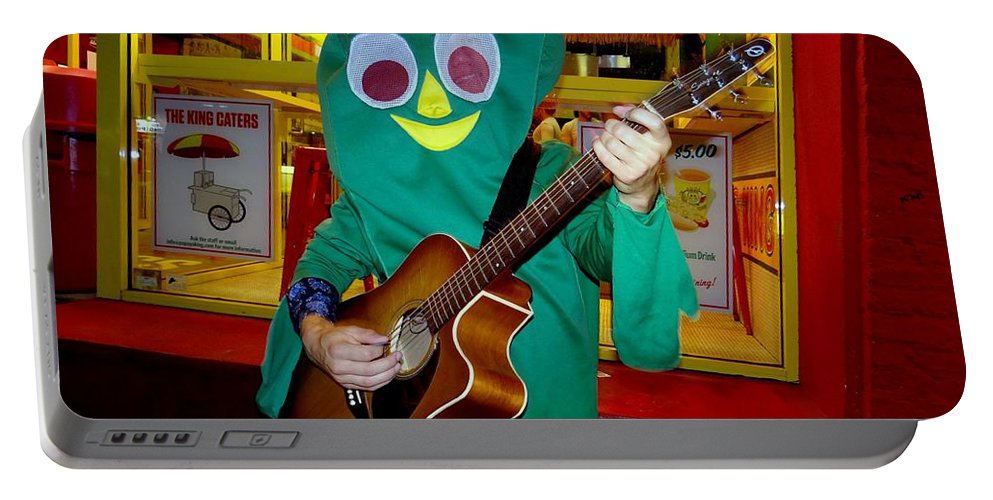 Gumby Portable Battery Charger featuring the photograph Street Corner Gumby by Ed Weidman