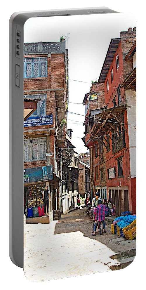 Street In Bhaktapur-city Of Devotees-in Nepal Portable Battery Charger featuring the photograph Street In Bhaktapur-city Of Devotees-nepal by Ruth Hager